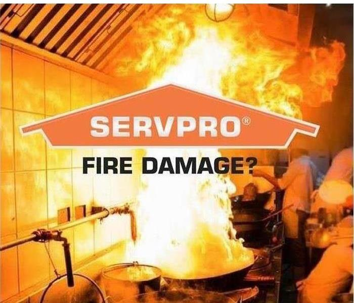 SERVPRO Logo with a Kitchen Fire in progress in the Background